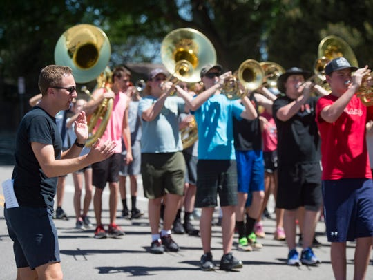 Nicholas Peterson claps along to the tempo as the Loveland High School marching band moves in formation during summer band practice in Loveland on Thursday, June 28, 2018. Peterson works as a counselor at Fossil Ridge High School in Fort Collins during the school year.