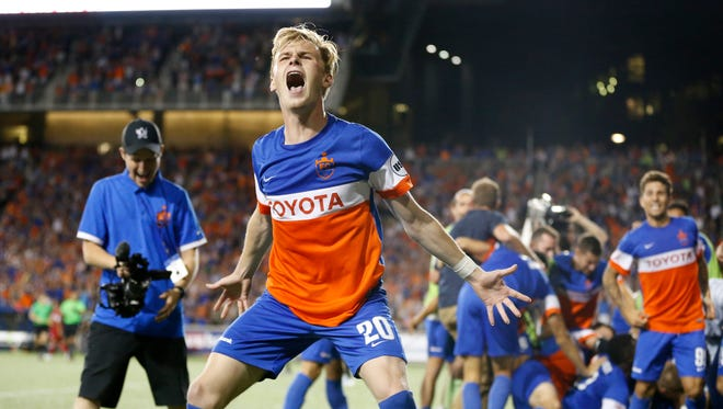 FC Cincinnati forward Jimmy McLaughlin (20) celebrates the win after penalty kicks during the Lamar Hunt US Open Cup match between the Chicago Fire and FC Cincinnati on June 28, 2017 at Nippert Stadium.