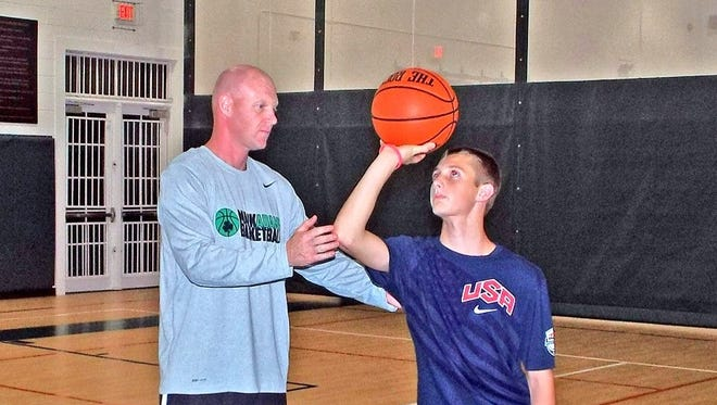 Professional trainer Mark Adams will hold a one-day clinic for youth basketball players on April 9 at Carolina Day.