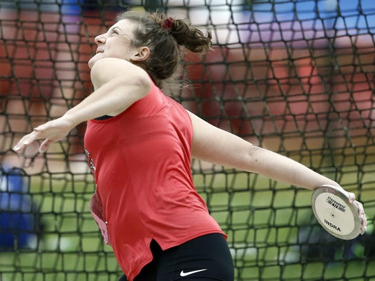 Dover's Emily Eckard, competes in the 3A discus, during