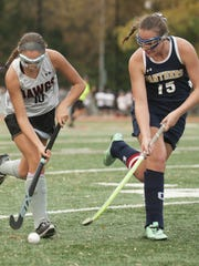 Haddonfield's Julia Battino, left, controls the ball as Collingswood's Dominique Hunt defends during Thursday's Central Jersey Group 1 field hockey championship game.