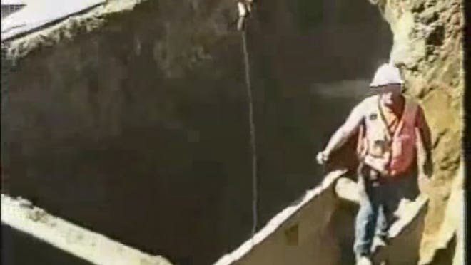 A worker captured in an OR OSHA video just before a partial trench collapse. The worker was not injured.