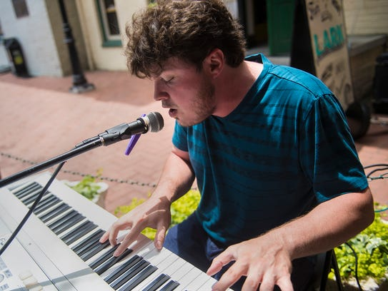 Musician Ethan Larsh performs off of the Gettysburg