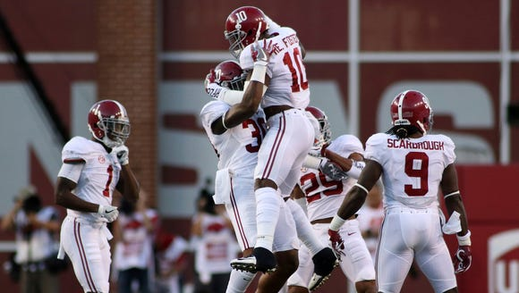 Alabama's Reuben Foster (10) and Mack Wilson (30) celebrate
