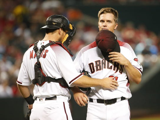 Starter Zack Greinke (right, with Jeff Mathis) didn't