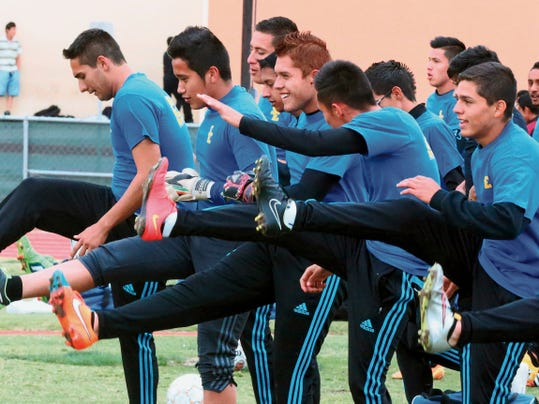 Rudy Gutierrez—El Paso Times The San Elizario boys soccer team stretches at the start of their Monday practice.
