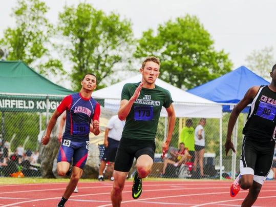 GREG HOLDER   FOR GAMETIMEPA.COM James Buchanan's Peter Hughey, center, churns around the last turn in the Class AAA 400-meter race in the District 3 Championships on Saturday at Shippensburg University. Hughey defended his title in a time of 48.12, beating CD East's Charles Bowman Jr., right, and Jeronimo Rodriguez of Lebanon, left.