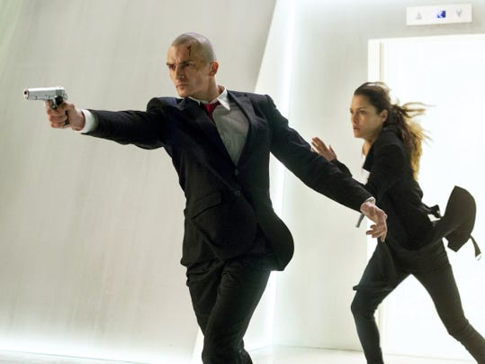 "Rupert Friend, left, and Hannah Ware appear in ""Hitman: Agent 47."""
