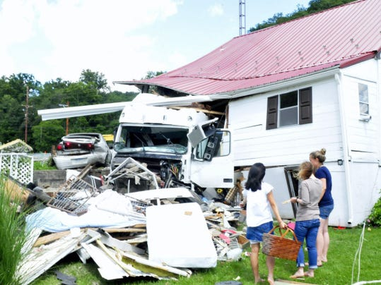 Debris is seen at the rear of a home at 14540  Buchanan Trail West, Cove Gap, following a crash, Wednesday, July 22, 2015. A tractor-trailer driver lost control of his rig and struck the house.