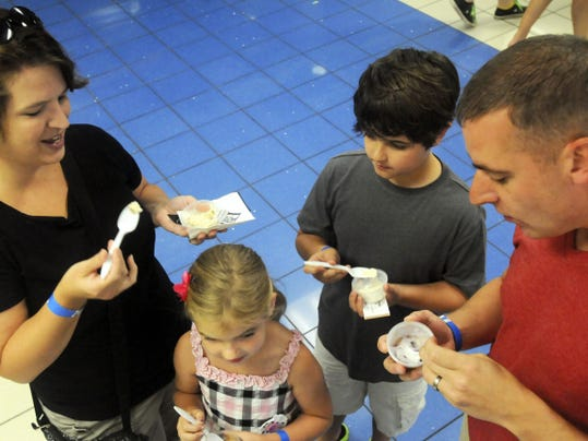 The LeVan family try ice cream samples at the 2014 Scoop-a-Palooza ChambersFest event at Chambersburg Area Senior High School on July 12, 2014. Scoop-a-palooza is one of the opening events of ChambersFest, July 11 this year.