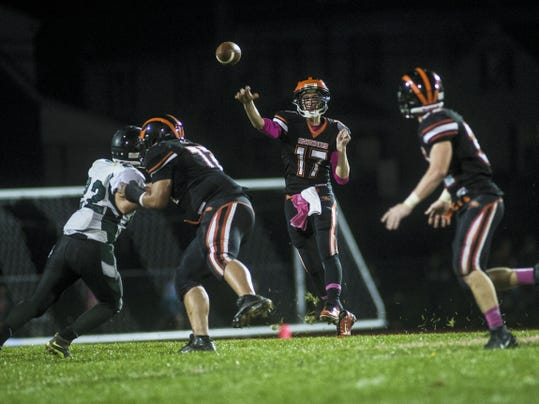 Hanover's Kyle Krout, center, delivers a pass during Friday's game against Fairfield at Sheppard-Myers Stadium in Hanover. Krout threw for 216 yards and three touchdowns in Hanover's 53-14 win.