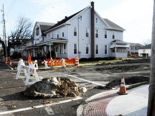 The intersection of East Cherry and South Grant streets in Palmyra shows the progress done in plugging the newly opened — and massive — sinkhole. The hole measures 75 feet long, 30 feet wide and up to 25 feet deep.