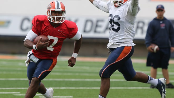 UTEP quarterback Kavika Johnson runs away from defender Armando Saldana during a scrimmage Friday at the Sun Bowl.