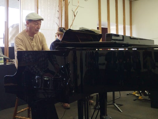 "Pete Revelle at the piano Tuesday during a ""Four on"