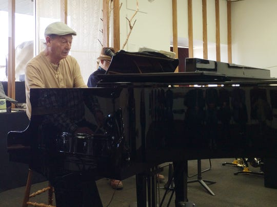 "Pete Revelle at the piano Tuesday during a ""Four on the Floor"" performance. He will be part of the Cultural Center house band during the B.W.D. concert series."