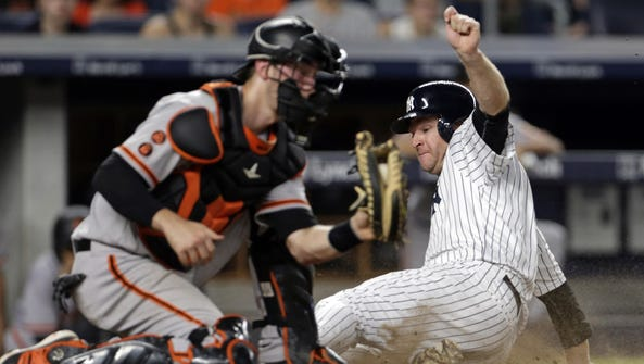 New York Yankees third baseman Chase Headley scores