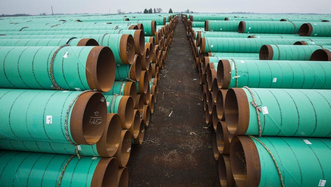 Enormous stacks of pipe in March, just east of Newton, Iowa, that are ready to build the Bakken pipeline.