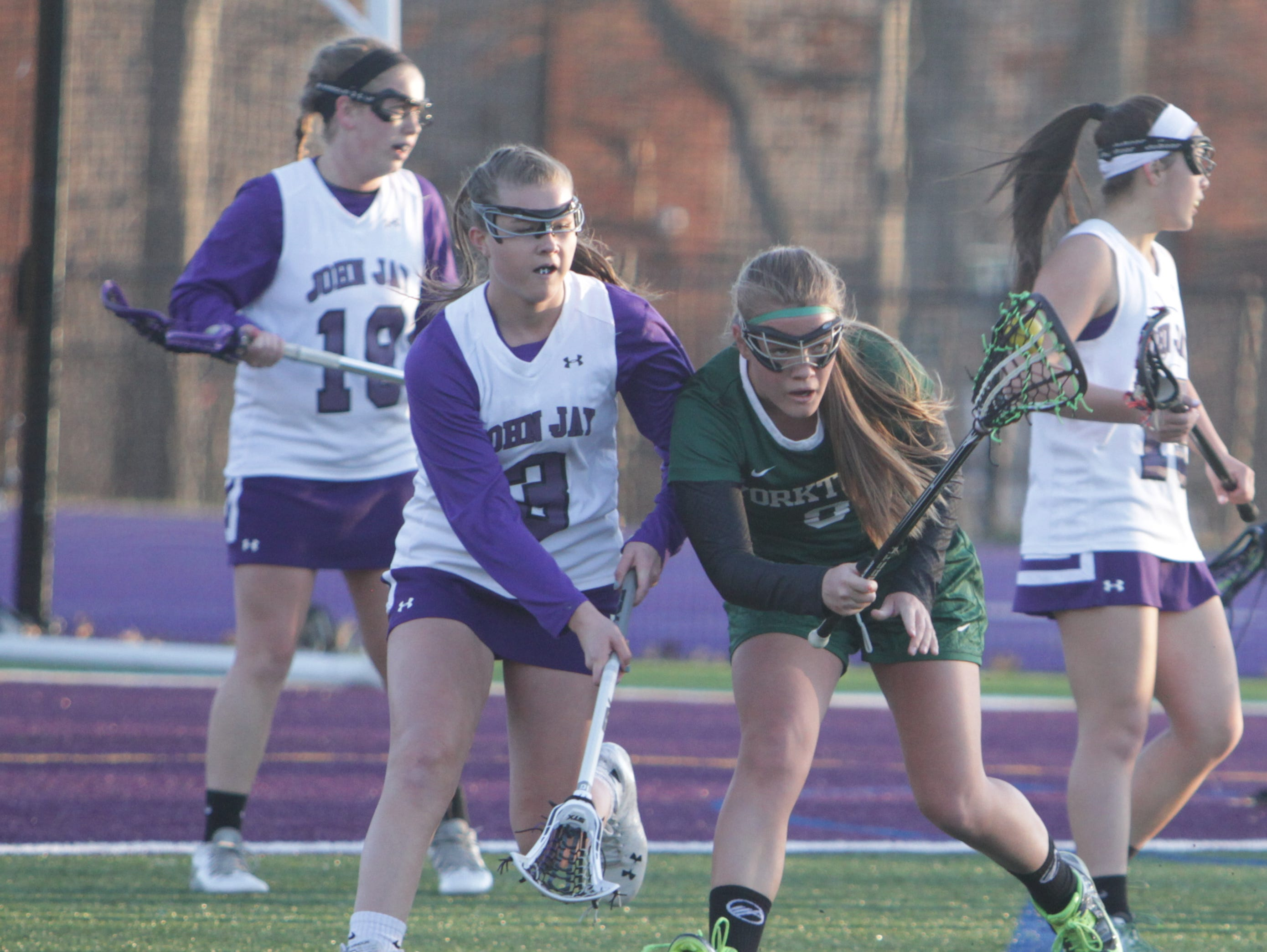 Game action during a Section 1 girls lacrosse game between John Jay and Yorktown at John Jay-Cross River High School on Tuesday, March 29th, 2016. Yorktown won 15-5.