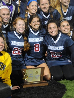 With their Group 4 title trophy, Eastern's  Nikki Santore (20), Maddie Morano (8) and Alanna Gollotto celebrate with their teammates.