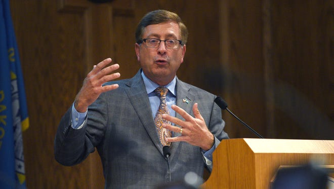 """Mayor Mike Huether gives a presentation titled """"The Reality Check"""" Tuesday, July 18, to City Council members at Carnegie Town Hall."""