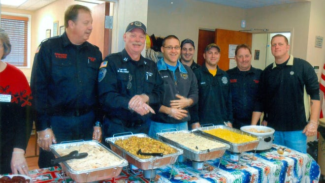 Members of the Millville Fire Department financed and served the annual Christmas dinner at the Millville Senior Center on Dec. 10.