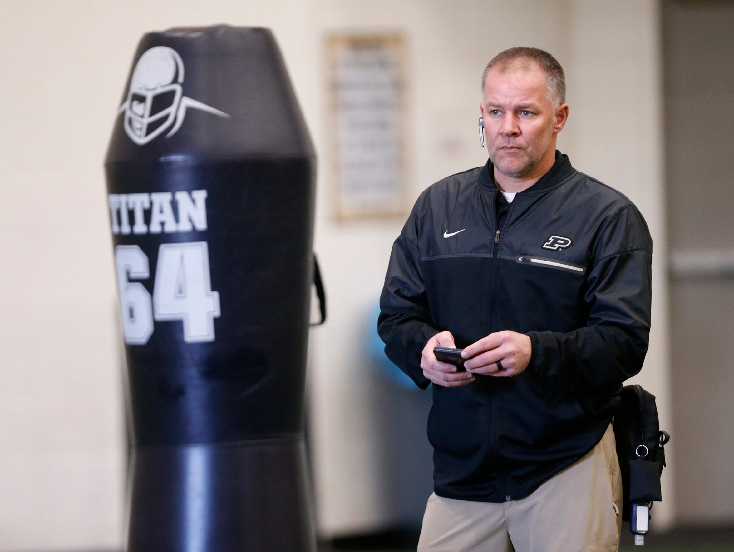 Doug Boersma, asociate athletic director-sports medicine, watches as players run drills during Purdue spring football practice Friday inside the Mollenkopf Athletic Center.
