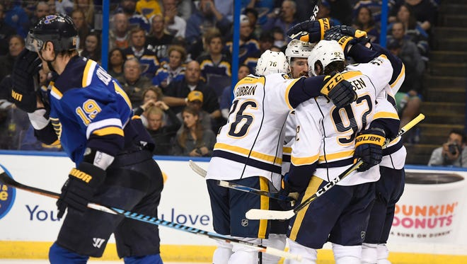 The Predators celebrate the goal by center Filip Forsberg (9) as Blues defenseman Jay Bouwmeester (19) skates by during the second period in game 1 of the second round NHL Stanley Cup Playoffs at the Scottrade Center Wednesday, April 26, 2017, in St. Louis, Mo.