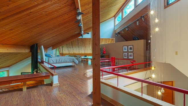 The master bedroom in the main part of the house is a loft.