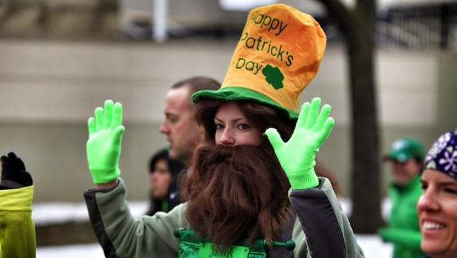 A runner is decked out in green at Saturday morning's race in Rochester.