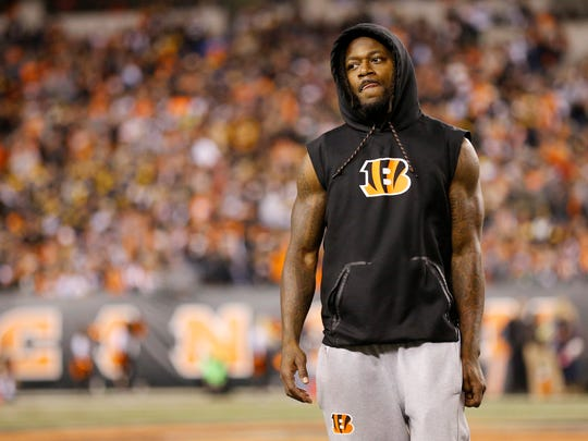 Cincinnati Bengals cornerback Adam Jones (24) returns to the sideline in plain clothes after leaving with a groin injury on the opening drive of the first quarter of the NFL Week 13 game between the Cincinnati Bengals and the Pittsburgh Steelers at Paul Brown Stadium in downtown Cincinnati on Monday, Dec. 4, 2017.