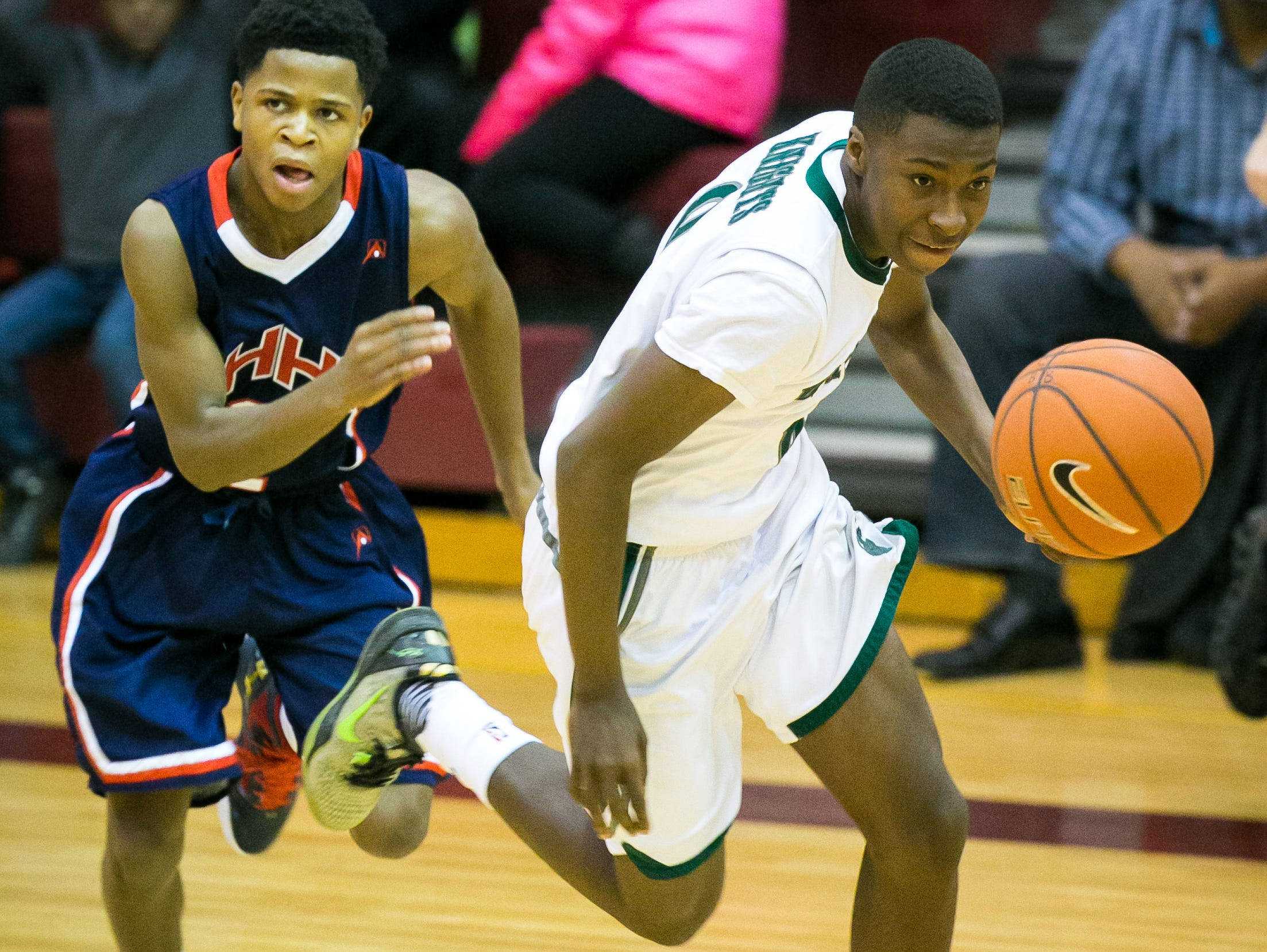 Raheim Burnett of Mount Pleasant steals the ball from Deshawn Latham of American History team at the 5th Annual Concord Classic.