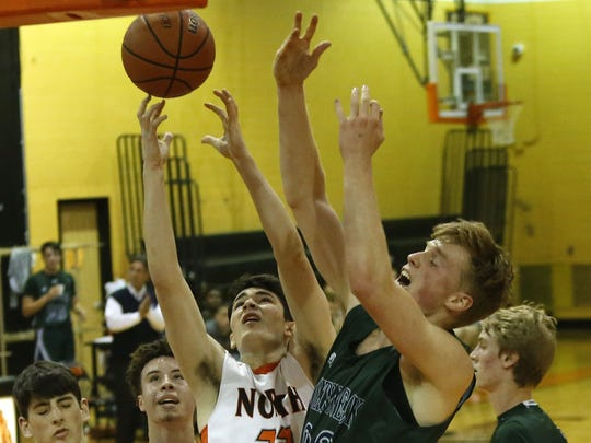 Chris Kenny (22) of Middletown North  battles  Rob Hill (22) of Colts Neck during  first round of NJSIAA  tournament boys basketball game at Middletown North High School. Monday, February 27, 2017. Middletown,NJ.   Noah K. Murray-Correspondent/Asbury Park Press  ASB 0228 Boys Hoops NJSIAA Tournament Roundup