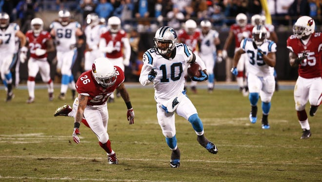 Carolina Panthers' Corey Brown runs for a touchdown past Arizona Cardinals' Rashad Johnson in the first quarter at the NFC Championship game on Jan. 24, 2016 in Charlotte, North Carolina.
