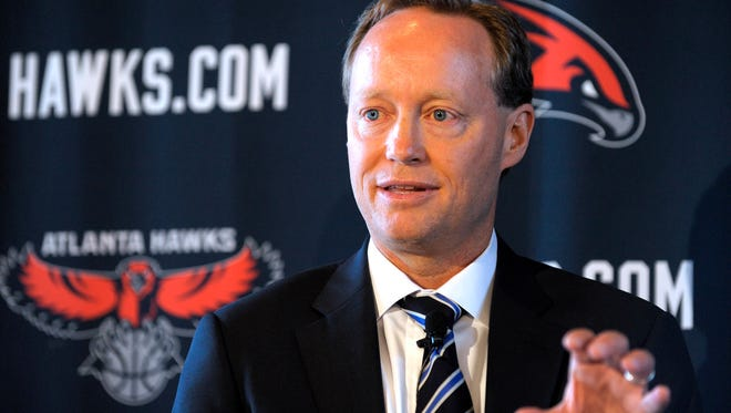 In this May 29, 2013, file photo, Atlanta Hawks head coach Mike Budenholzer gestures during an NBA basketball news conference in Atlanta.