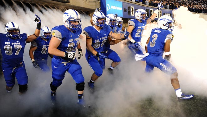 Members of the Air Force football team run out onto the field before the start of their Sept. 21 game against Wyoming at Falcon Stadium.
