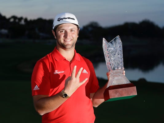 Jon Rahm poses with the trophy after winning the CareerBuilder Challenge golf tournament on the Stadium Course at PGA West, Sunday, Jan. 21, 2018, in La Quinta, Calif. (AP Photo/Chris Carlson)