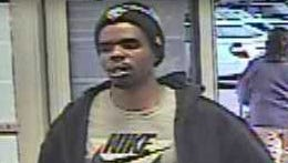 The suspect is seen entering the store.