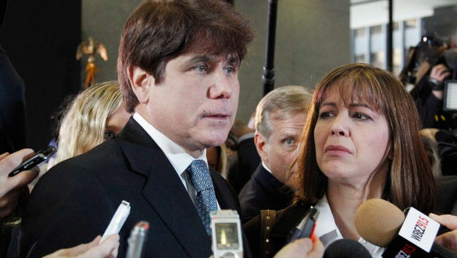 In this Dec. 7, 2011 file photo, former Illinois Gov. Rod Blagojevich, left, speaks to reporters as his wife, Patti, listens at the federal building in Chicago.A federal judge will decide Tuesday, Aug. 9, 2016, whether to cut the 14-year prison term given to Blagojevich after he was convicted of corruption, including charges that he tried to exchange an appointment to President Barack Obama's old U.S. Senate seat in exchange for campaign donations.