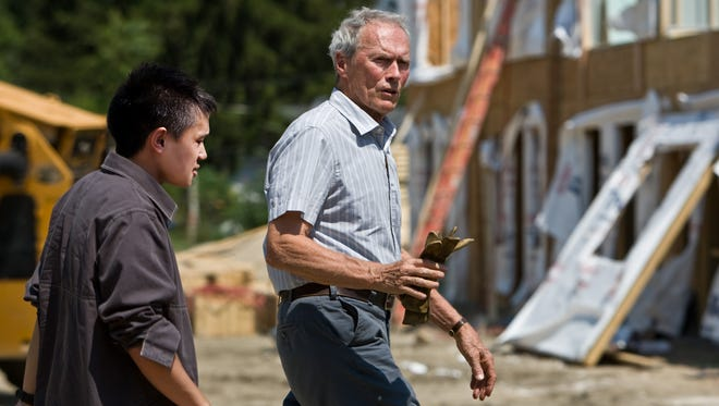 """In this image released by Warner Bros. Pictures, Bee Vang, left, and Clint Eastwood are shown in a scene from, """"Gran Torino,""""  which was filmed in Michigan."""