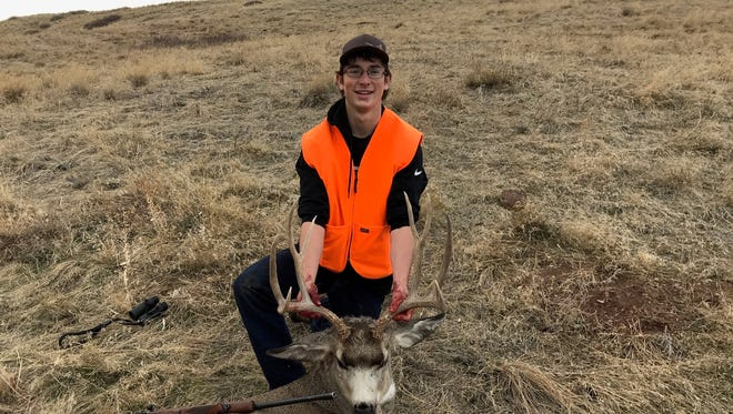 "Robbie Flinn harvested this deer on Enger Cutoff Road near ""Wayne Tunnel"" during Thanksgiving weekend."