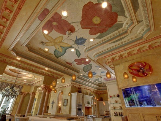 The ceiling above the kitchen is hand painted mosaic