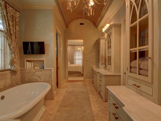 A spa like bath accompanies the master suite.