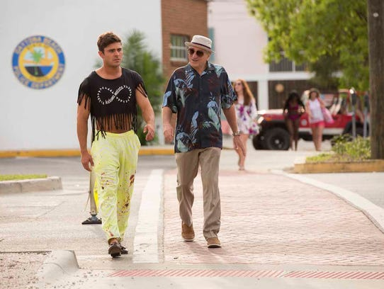 Zac Efron (left) has to contend with a grandfather