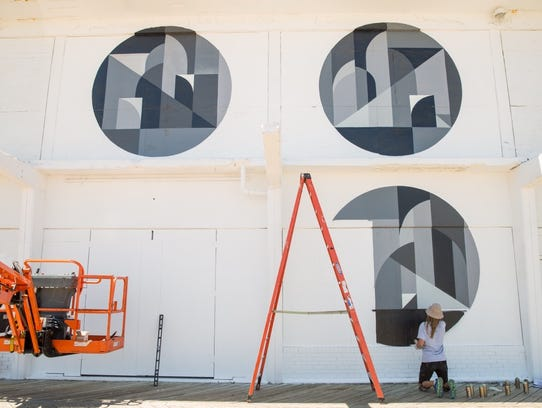 Rubin paints his mural on the Sunset Pavilion on the