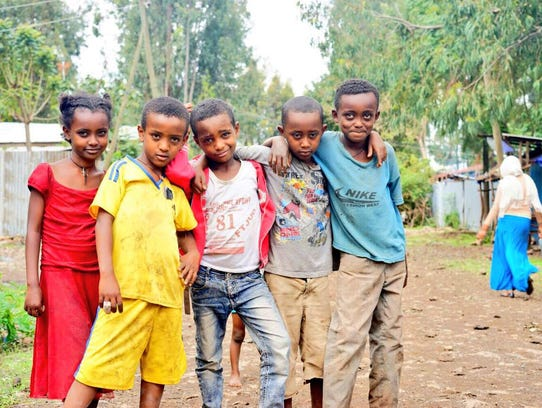 Children pose outside of a village in Ethiopia during