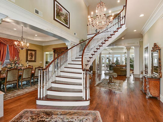 A beatiful staircase graces the grand entrance of the