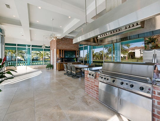 The outdoor kitchen is fully equipped with top of the