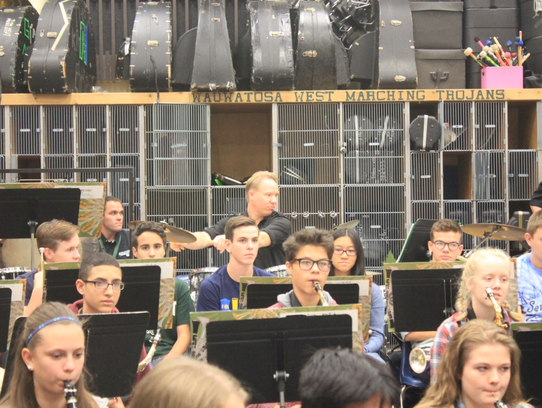 Tosa West Concert Band students play with Logan Penington