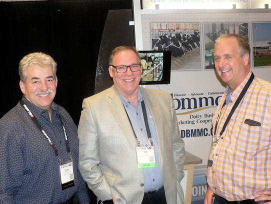 Tim Trotter,  DBA  Executive Director (center) and