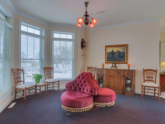 Antiques, especially antique light fixtures, abound